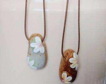 Handmade flower stone glazed pendant on waxed cord