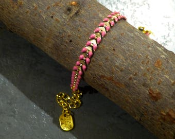 Made & chained enameled gold spike bracelet