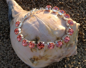 Swarovski Peach 8mm 15 crystal bracelet, adjustable w/extension and lobster clasp