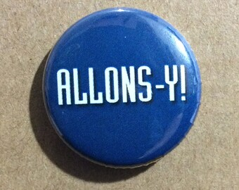 """1"""" Button - Allons-y!"""