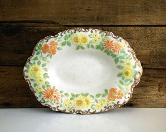 Vintage floral bisque trinket dish