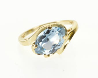 14k Blue  Topaz Marquise Prong Set Wavy Bypass Ring Gold