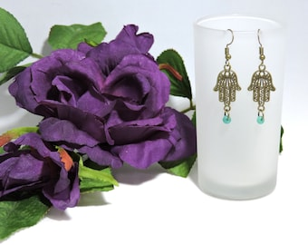 Antique Bronze Hand Earrings with blue bead