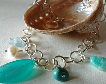 Solid silver bracelet with semi precious, silver and resin charms.
