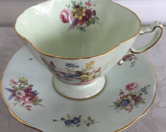 Hammersley tea cup and saucer, light pale blue/green with multi colored flowers, gold trim