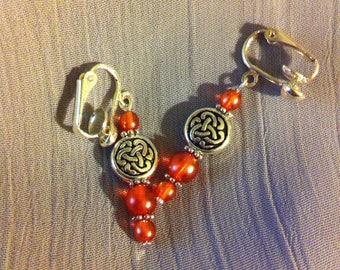 Rose color beads and silver clip on earrings with Celtic knot beads