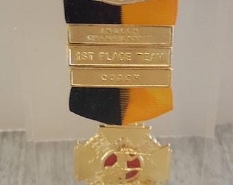 1960 Infantry Division Marksman medal encased in lucite.