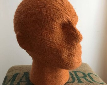 Hand made string head in burnt orange by Amanohome