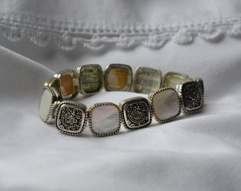 Monet metal and mother of pearl strech bracelet