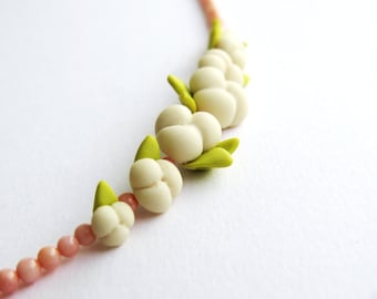 Polymer clay Pansies with green leaves necklace between pink corals