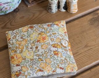 Sewing case or kit in Hello Kitty Liberty Japan tana lawn and sparkling metallic silver Essex linen, with hand stitched detailing