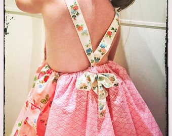 Girl's dress with strawberry print combined with geometric design