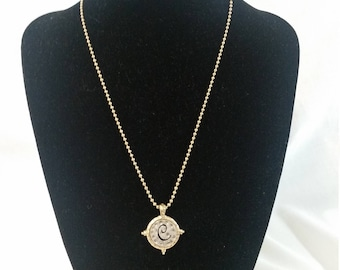 Gold and silver initial necklace