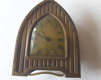Brass clock, ticks and works!