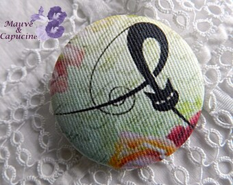 Button in green fabric, 32 mm / 1.25 in
