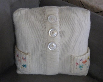 White Cable Knit Sweater Pillow with Embroidery on Pockets
