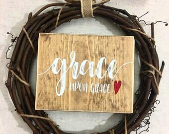 Grace upon grace sign