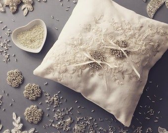 Ivory ring pillow with lace and pearls