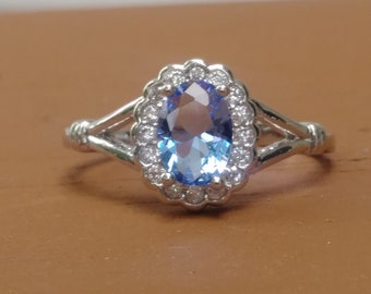 Tanzanite sterling silver womens ring surrounded by cubic zirconia