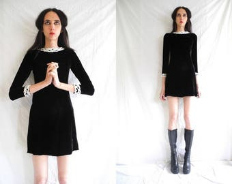 60's goth black velvet long sleeve shift mini dress with white lace contrasts.