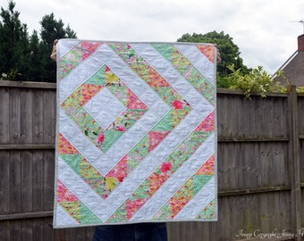 Floral baby quilt.  Bright girls quilt. Quilted baby blanket, crib quilt or play mat.  Modern contemporary sophisticated quilt UK