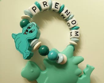 Dinosaur turquoise, Teal and white seal teething rattle