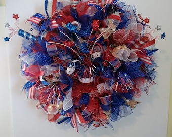 This bright and colorful Fourth of July wreath will look good on any door. For 4th of July or Memorial Day. It lights up at night.