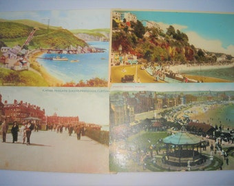 Four vintage postcards all with seaside views