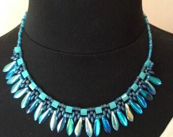 Crew neck in weaving of Czech glass beads, daggers 1 hole, clear iridescent blue