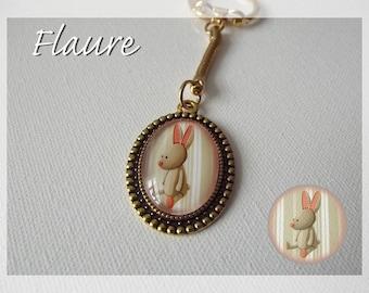 """a keychain """"A cuddly rabbit """""""