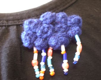 crocheted blue, rainy cloud brooch