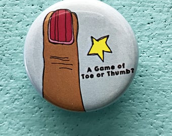 1.25 Inch A Game of Toe or Thumb Button: Humorous Button, Funny Buttons, Toe Lapel Button, Thumb Lapel Button
