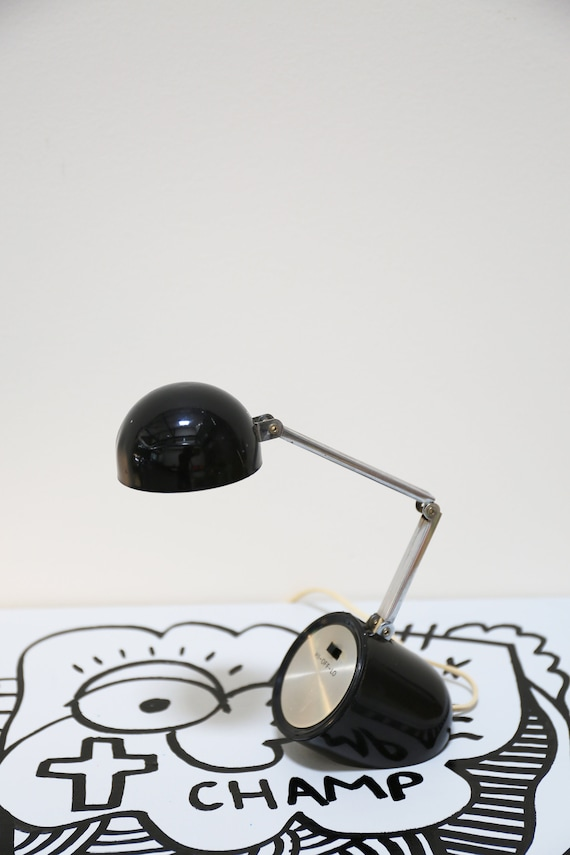 Pill Shaped Black Plastic Outfitted Mini Desk Lamp