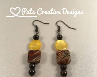 Kaleidoscope of Color - Yellow Round Glass Bead - Square Bead with an array of warm Browns - Yellows - Reds with small round brown beads
