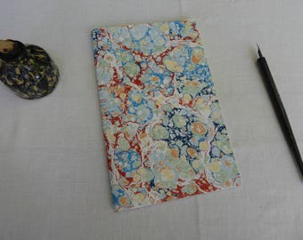 Blue, red, black and yellow hand marbled paper hand sewn notebook, lined paper