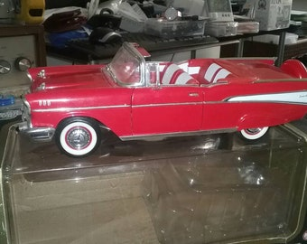 1957 diecast 1:18 scale red Chevrolet Bel Air with box.