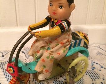 Vintage windup toy tin toy boy on bike