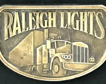 1980's Trucker Belt Buckle Big Rig Raleigh Lights