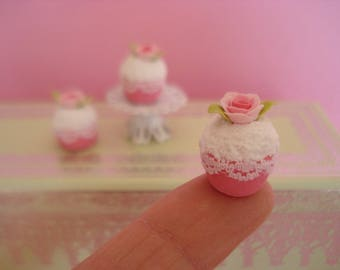 1 small CUPCAKE Strawberry whipped cream and pink decor