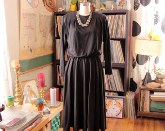 vintage 1980s minimalist black dress . 80s does 40s jersey knit dress, bloused with long swing skirt . womens size small medium