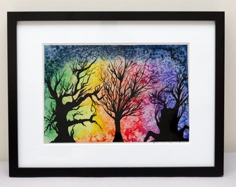 Black trees on a rainbow coloured background in a watercolour painting