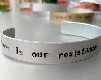Muse, handstamped bracelet, love is our resistance, bangle for muse lovers, jewellery handstamped, engraved by hand, Matt Bellamy, Resist