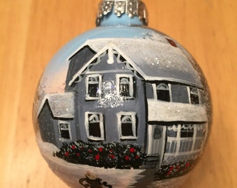 Hand painted  glass ornament with a winter scene