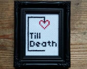 Fino alla morte, punto croce.