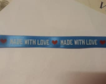 pretty Blue Ribbon writing made with love and Red hearts