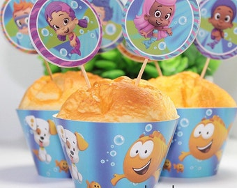 12 sets the  bubble guppies  cupcake toppers and wrappers