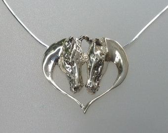 Horses heart sterling silver pendant and chain. Signed piece Zimmer