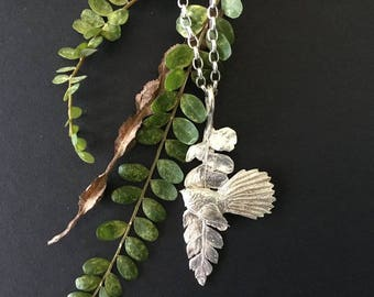 Handcrafted Silver Fantail on Fern