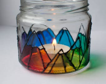 Rainbow, snow capped mountain range, hand painted glass candle holder.