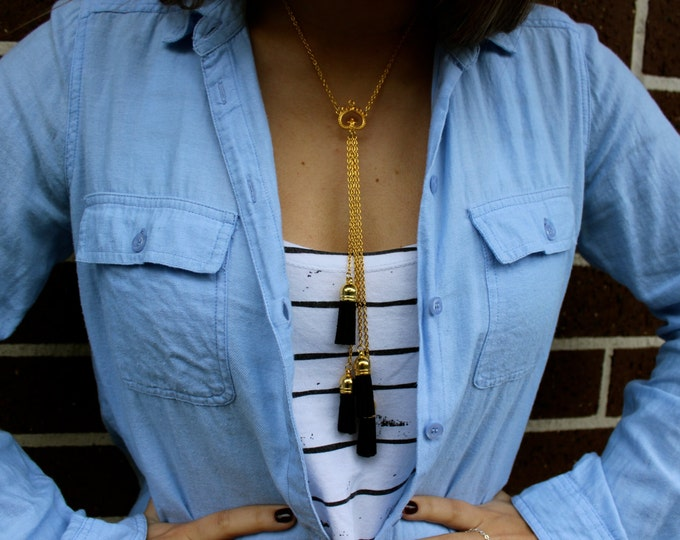 Gold and Black Leather Tassel Necklace.